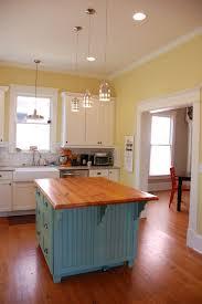 blue kitchen cabinets and yellow walls portfolio four one design yellow kitchen walls