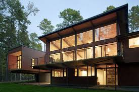glass walls lighting deck house renovation in chapel hill north