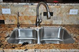 kitchen faucets for granite countertops granite countertops and tile backsplash ideas eclectic kitchen