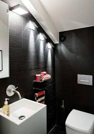 dramatic bathroom wall lighting design with black color wall