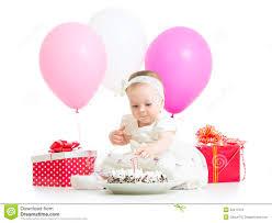 baby girl birthday baby girl touching light on birthday cake royalty free stock