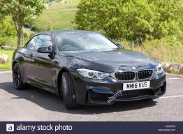 black convertible bmw f83 black bmw m4 convertible 2 door coupe with red leather parked