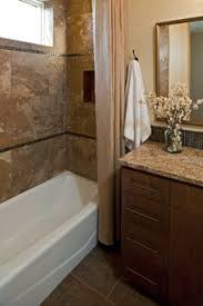 master bathroom tile shower with half wall on one side could