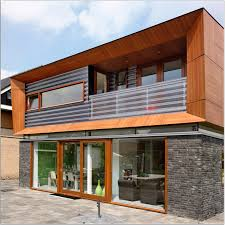 stylish modern house design idea with gray stone wall black door