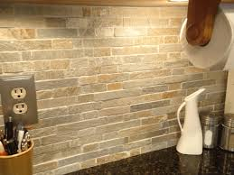 stone backsplash in kitchen light gray wooden sink sleek white