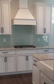 kitchen white quartz countertops and the backsplash is carrera