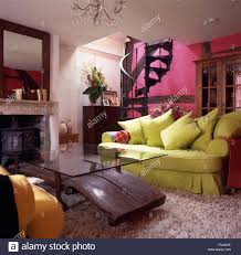 lime green sofa and unusual glass wood coffee table in a fuchsia