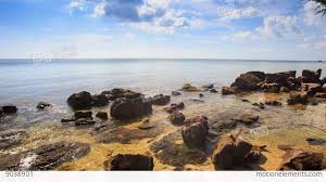 Beach Transparent by Rocks Under Above Transparent Shallow Water By Beach Stock Video