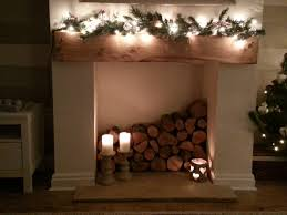 wood logs stacked i dont like candles much tho pinteres wood logs stacked i dont like candles much tho more empty fireplace ideas fireplace fillercandles in