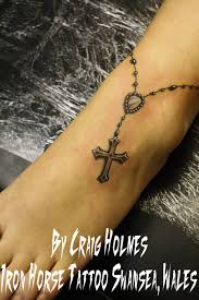 black cross rosary tattoo on foot and ankle