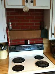 red brick backsplash under white wooden cabinet above stove ideas