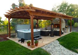 outdoor a courtyard with a wooden roof and sofa cushions also