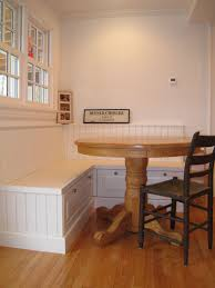 white corner teak bench for big round table with beadboard and
