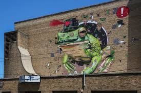 milwaukee s urban art scene expands with black cat alley wuwm mto s giant frog mural on the south side of the oriental theater