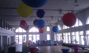 inflated balloon delivery 3fts and 5fts air inflated and rigged from roof palace