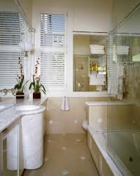 42 jaw dropping bathrooms by top designers worldwide photos small marble accent tiles between warm beige ties the walls and floor into the narrow countertops