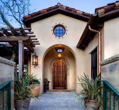 faux copper gutters entry mediterranean with rustic front door