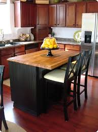 black kitchen island with seating loving this island makeover i plan to add beadboard to mine and