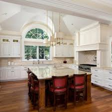 55 great ideas for kitchen islands the popular home by placing certain amenities low down on your island like a microwave or refrigerated drawer kids can easily help themselves to an afternoon snack or