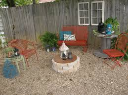 mismatched wrought iron chairs spray painted paprika pea gravel