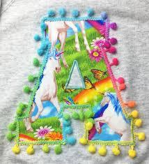 personalised kids sweatshirt with unicorn print letter by zilla