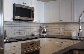glazed brick was used to create the modern backsplash for this