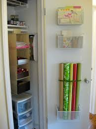 ways to store wrapping paper mounting baskets for gift wrap stationery storage to a door