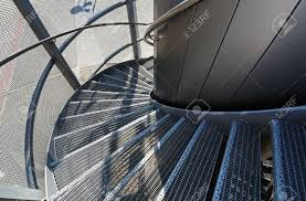 metal spiral staircase near a modern building spiral stairs