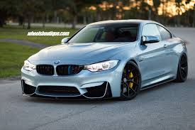 matte teal car bmw m4 tries on matte black wheels on a lowered body