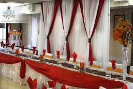 red and white table decorations for a wedding red and white and orange fall wedding backdrop and head table