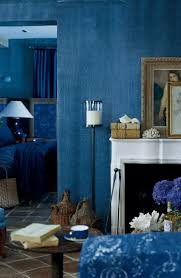 Textured Painted Walls - partly painted blue wall finished blank paint cans paintbrushes