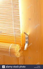 bamboo roller blinds sun shades on wooden door of garden summer