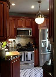 Cherry Kitchen Cabinets With Granite Countertops Cherry Wood Cabinets Black White Hexagon Tiles Hicks Pendant