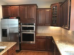 how to whitewash brown cabinets whitewashed travertine backsplash 2 cabinet
