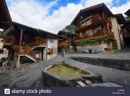 traditional fountain and old homes le chable val de bagnes stock