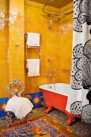 best 25 orange bathrooms ideas on pinterest orange bathroom the bohemian bathroom features usage of a burst of colors patterns vintage clawfoot bathtub ethnic carpet and all that is not convenient and likely for a