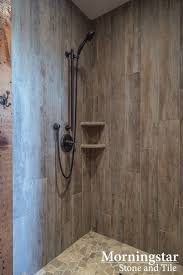 rustic modern farmhouse bath tour shower stall with wood like tile that has a rustic yet modern