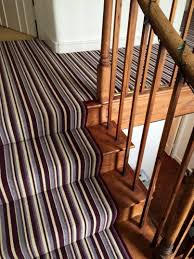 striped carpet stairs landing with design picture 22947