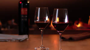 glass of wine glass of red wine stands on table backdrop hall of restaurant