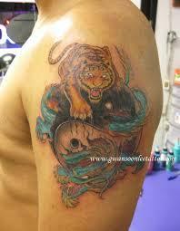 colour tiger and ying yang on armgwan soon