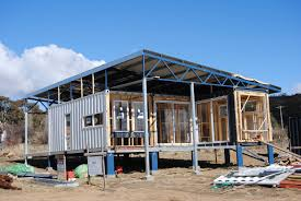 interesting start on a shipping container house the back container