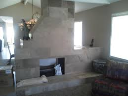 stone fireplace in center of room
