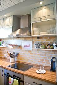 eat on kitchen island kitchen painted faux brick backsplash with wood countertops