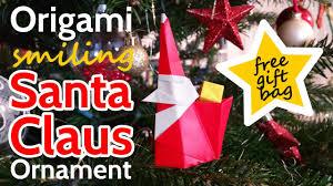 smiling origami santa claus with gift bag easy diy christmas