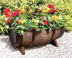 madly whimsical wine barrel planter ideas inhabit zone