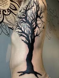 tree tattoo by rainfire tattoo