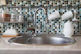 how to open kitchen faucet the concept of wasteful use of water open kitchen faucet spouting