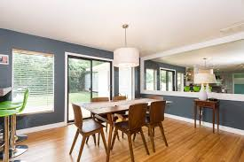 modern dining room with pendant light u0026 hardwood floors in tulsa