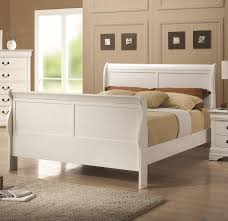 bedroom twin sleigh bed white dark hardwood pillows desk lamps