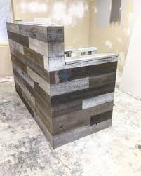made reclaimed wood multi tone reception desk by genuine